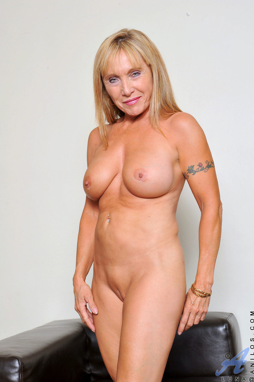 Busty mature blonde Luna reveals her phenomenal body and toys herself