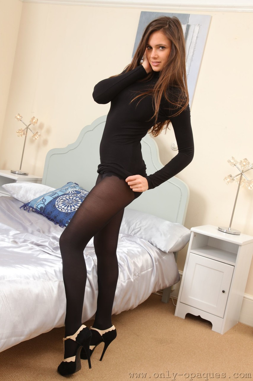 Skinny cutie Louisa Marie removes her tight dress and poses in a black bra