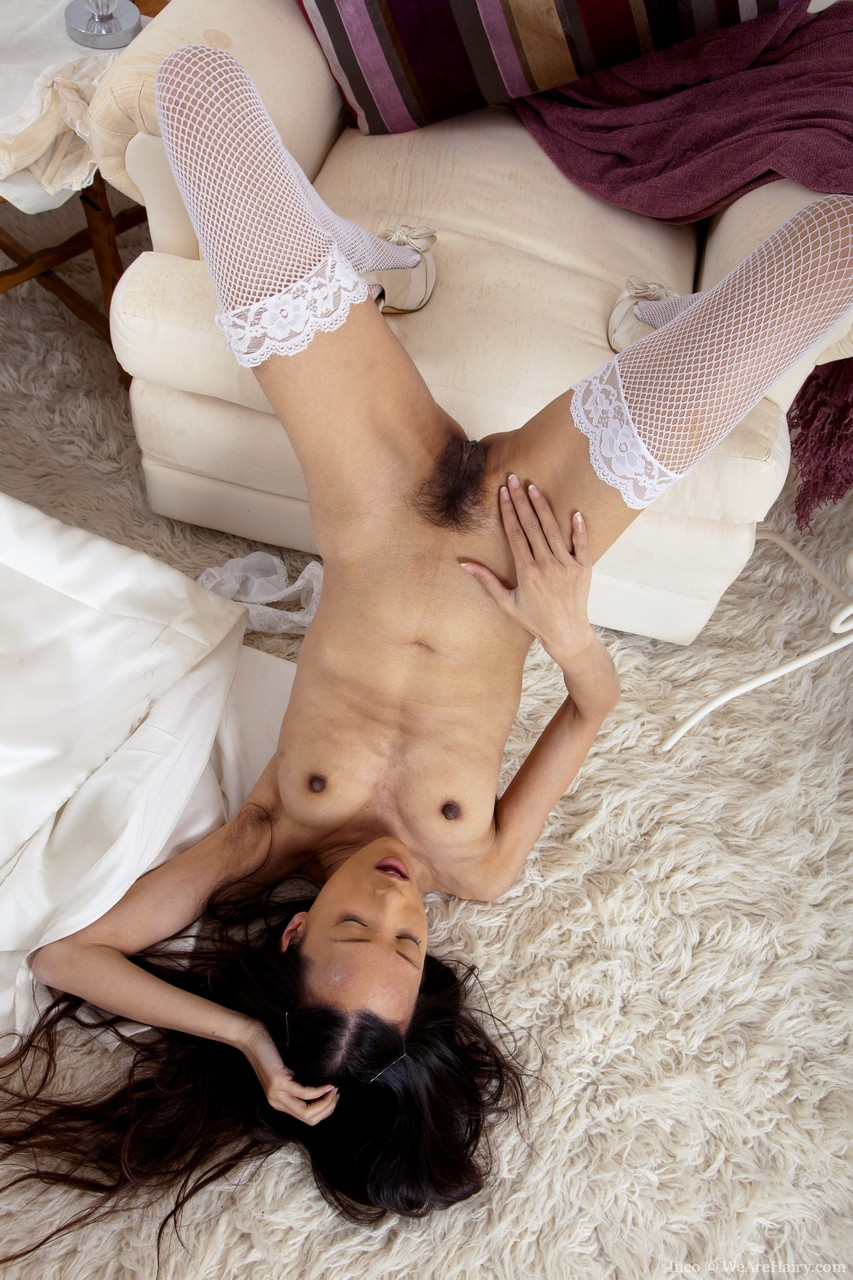 Black haired Asian amateur Inco exposes her hairy twat wearing white fishnets