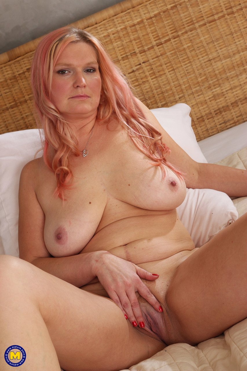 Big-breasted mature housewife Thekla M servicing her hungry pussy with a dildo