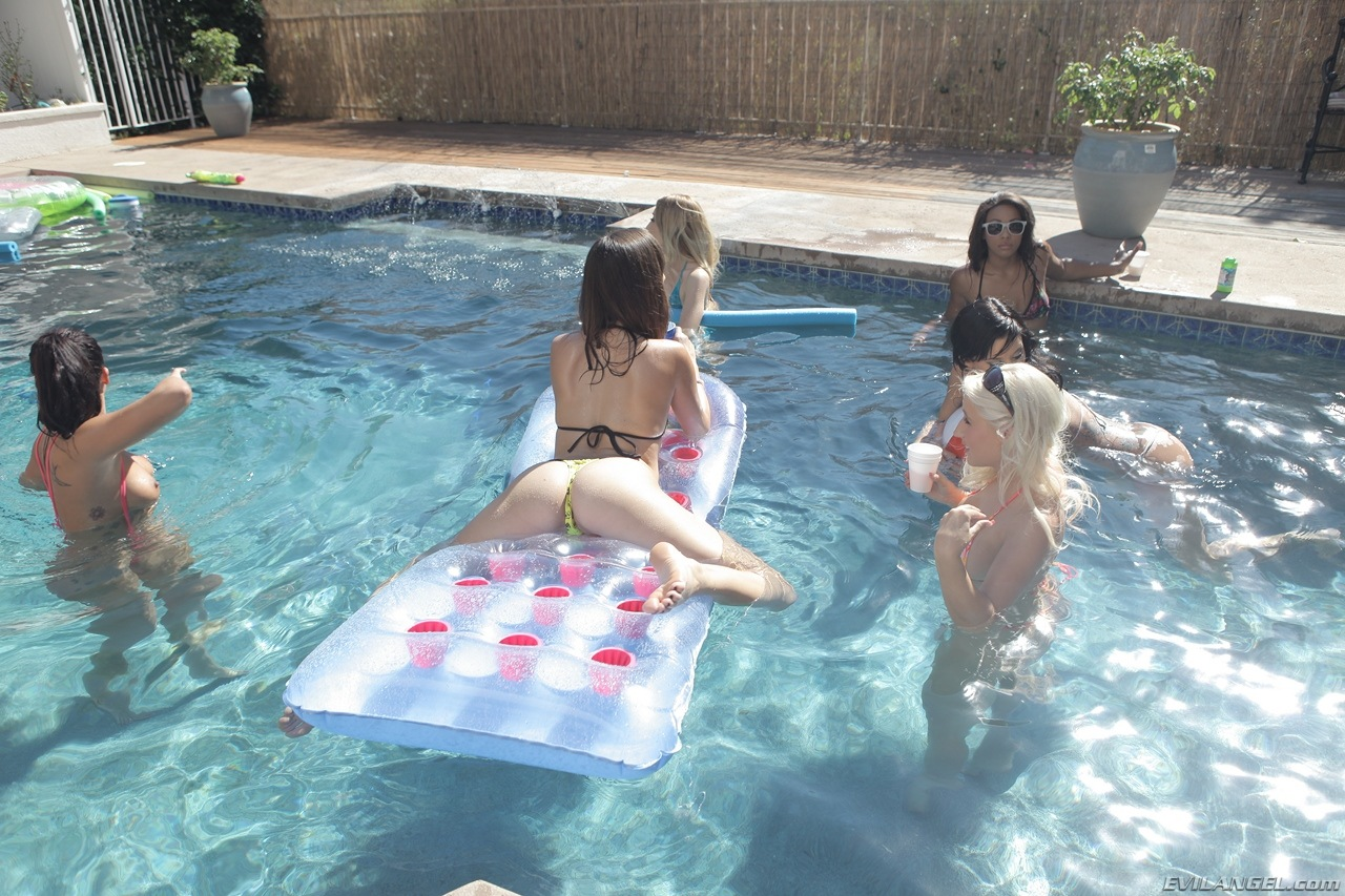 Hot lesbian babes turn a pool party into a lesbian strap-on group sex bash