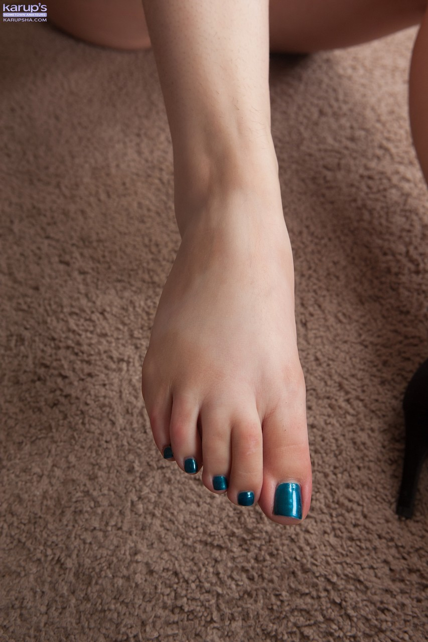 First timer Amy Faye shows her painted toenails after exposing her full bush
