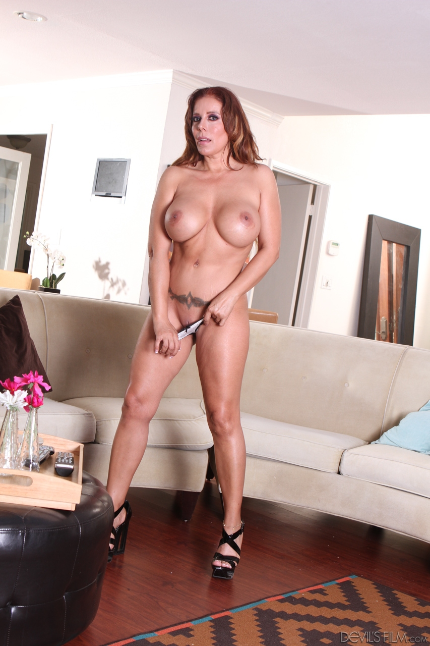 Chubby mature wife Nicky Ferrari uncovers huge big tits to pose naked in heels