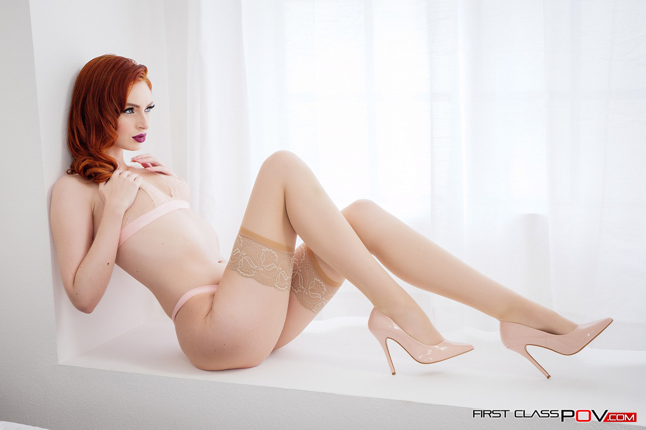 Redhead girlfriend in lacy stockings Maya Kendrick poses alone in a bedroom