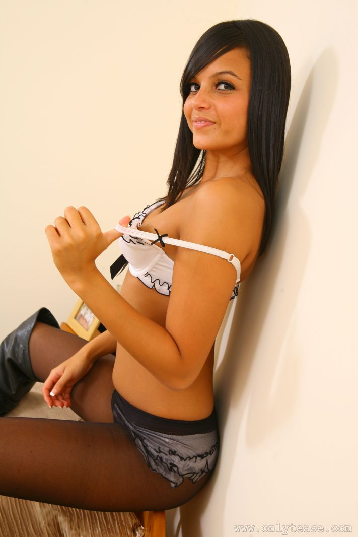 Teen solo girl with black hair doffs microskirt in lingerie and pantyhose
