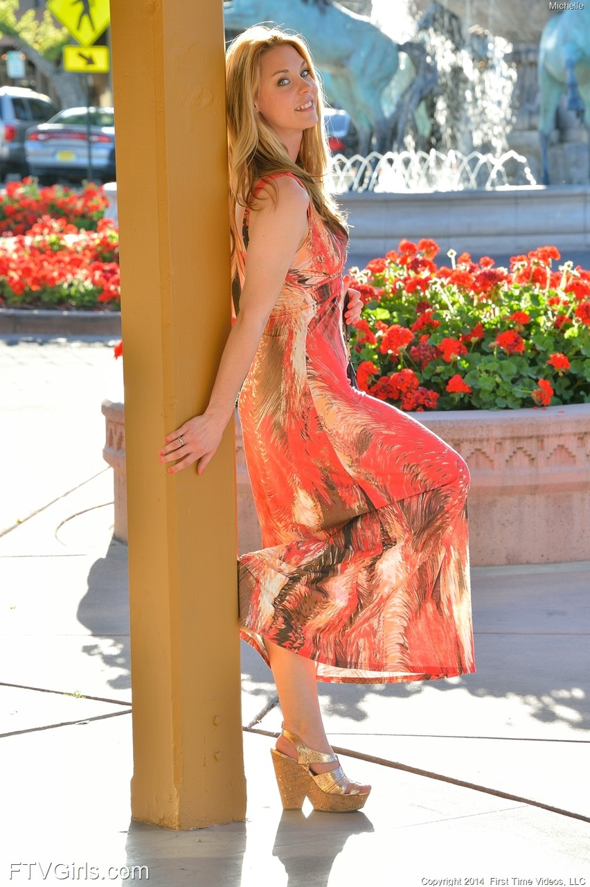 Glamour babe in a sexy dress Michelle flashing a pantyless upskirt in public