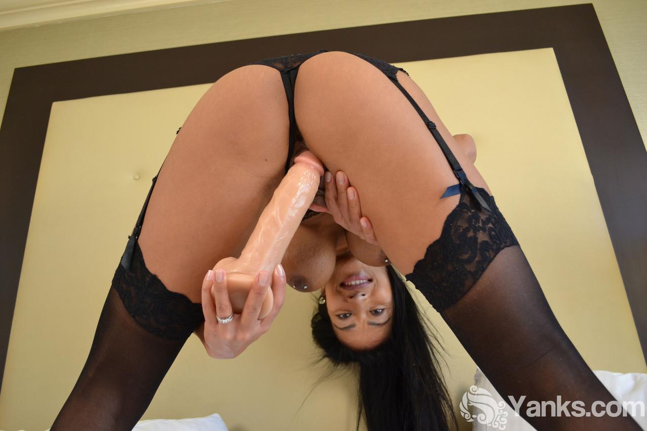 Busty brunette Tia Wileah toys her pierced twat in modeling debut