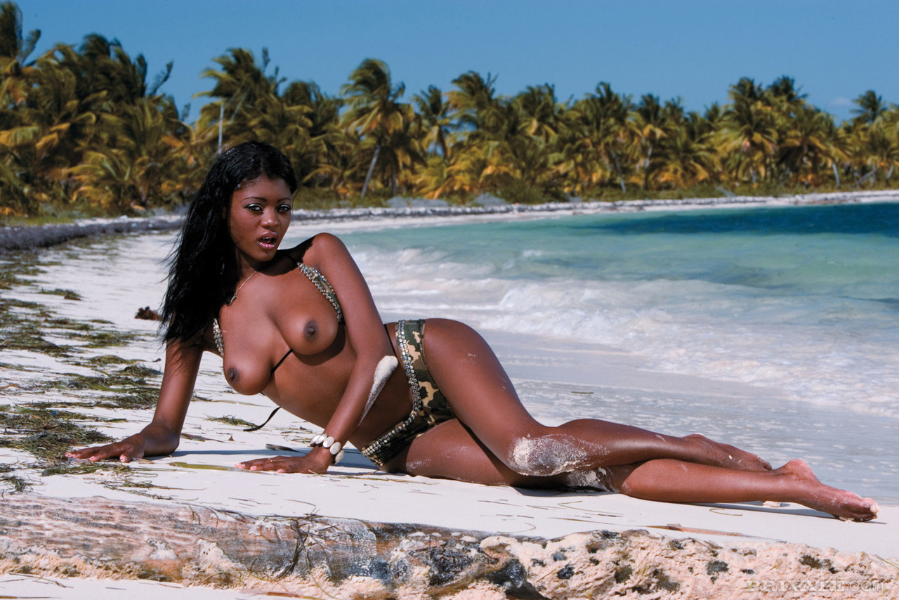 Hot black girl takes an open mouth cumshot after anal sex on a tropical beach