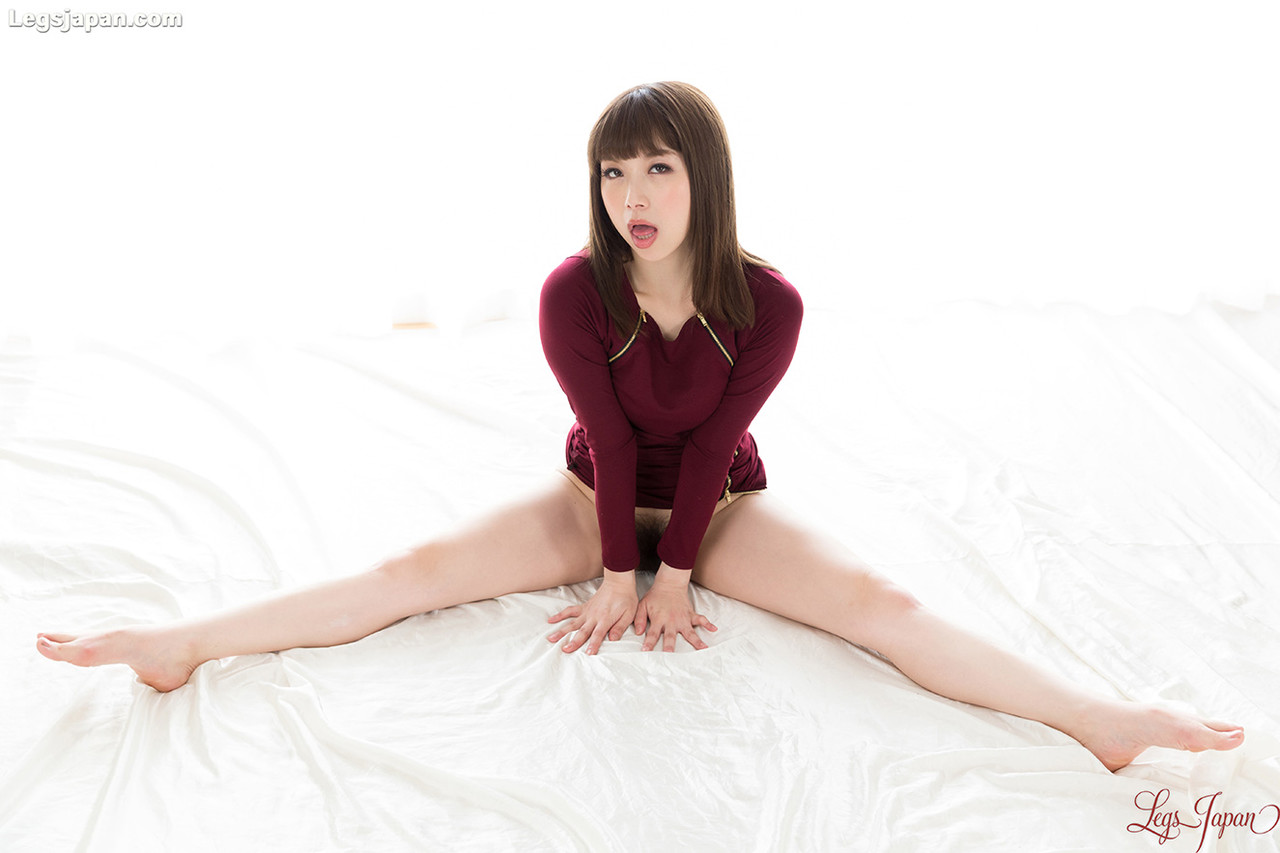 Japanese Asian girl showing off bare feet and hairy pussy wearing short skirt