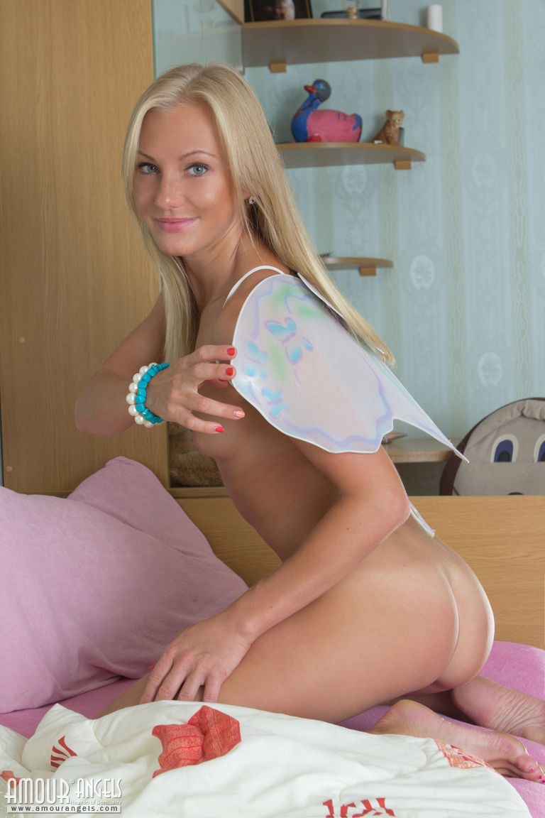 Petite blond teen with tiny tits eventually shows her meaty labia lips