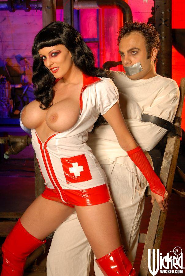 Slutty nurse Stormy Daniels calms down a violent patient with a BJ & fucks him