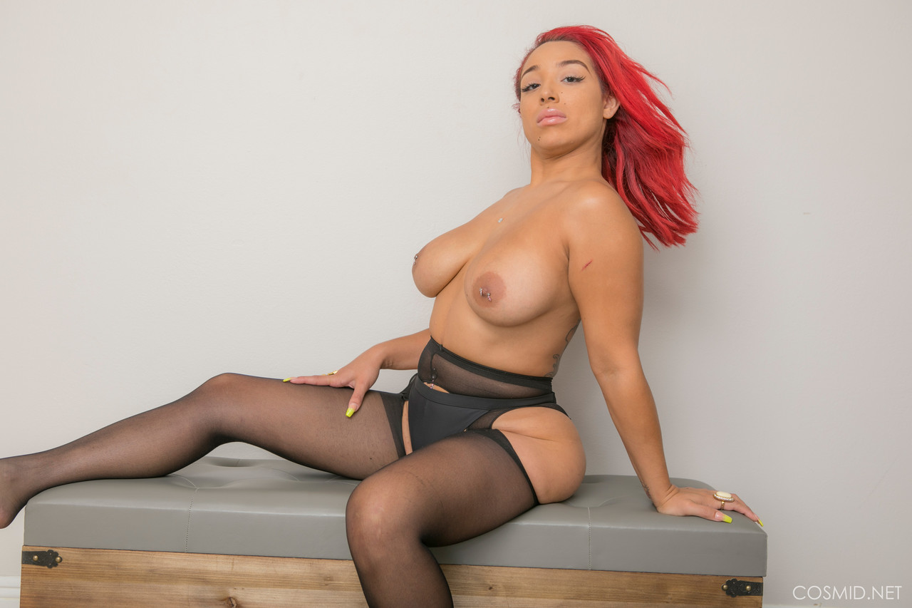 Tattooed amateur Rose Valley shows her big black tits in sexy pantyhose