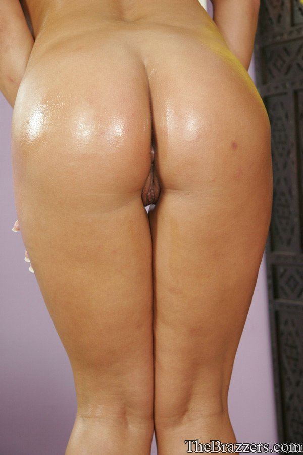 Horny blonde cougar Shyla Stylez displays her huge fakes and shiny ass