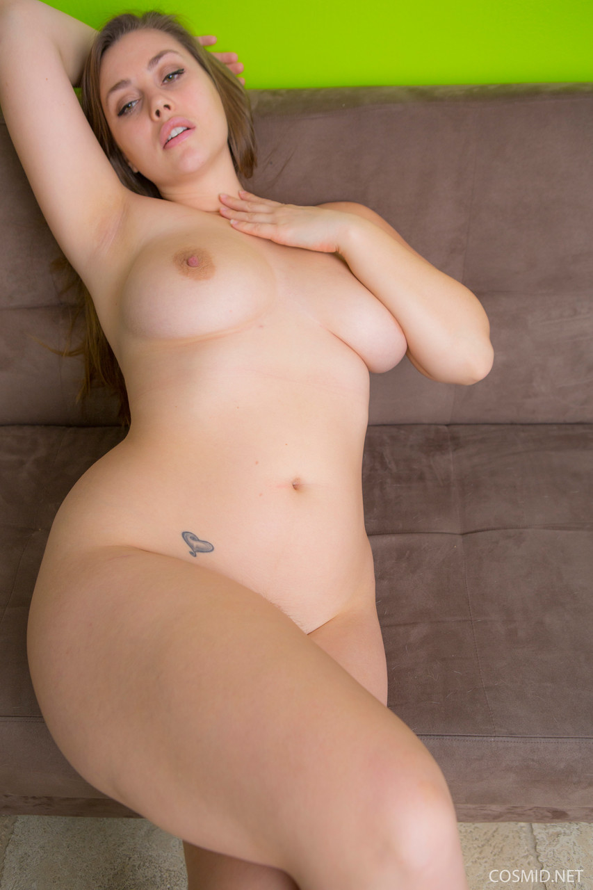 Busty beauty slowly undressing to bare big BBW tits and hairy twat