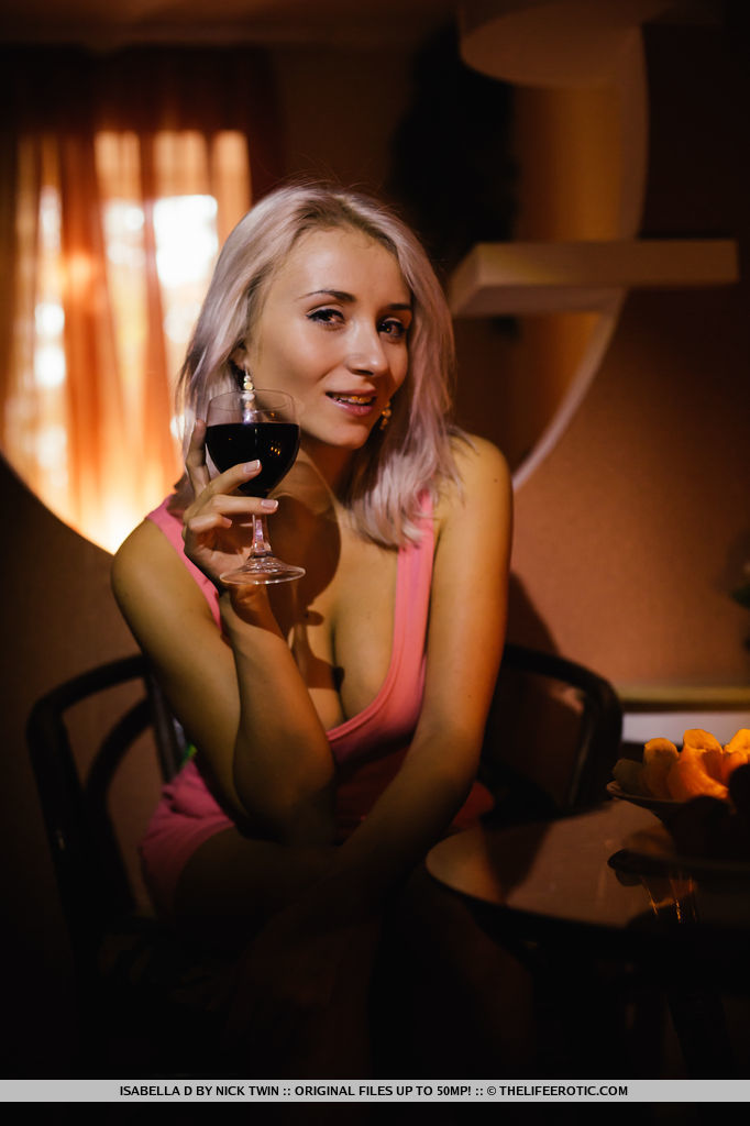 Platinum blonde model Isabella D gets totally naked over wine and berries