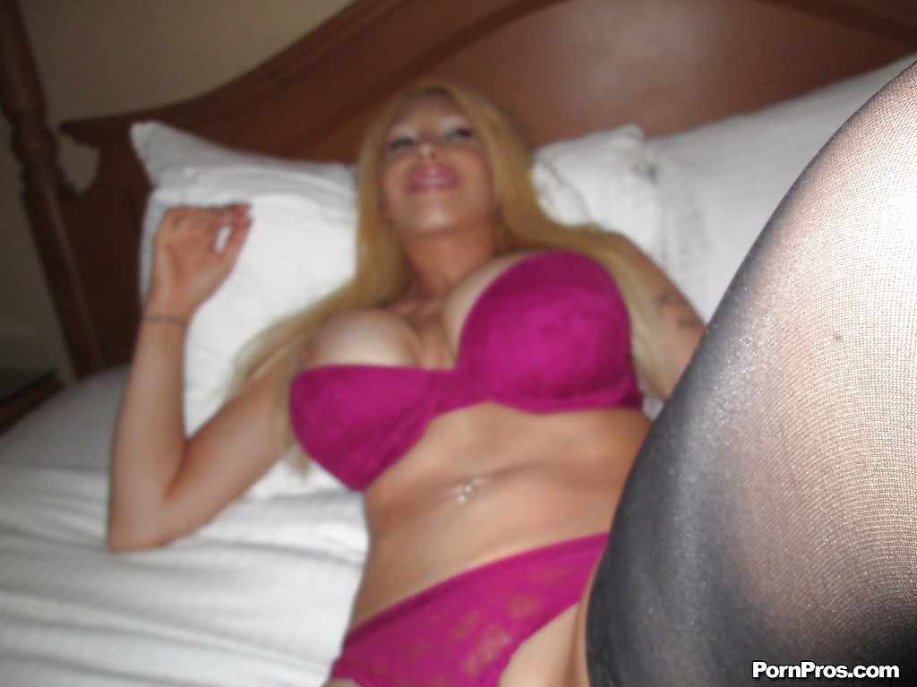Big busted blonde Candy Manson slipping on her lingerie and stockings