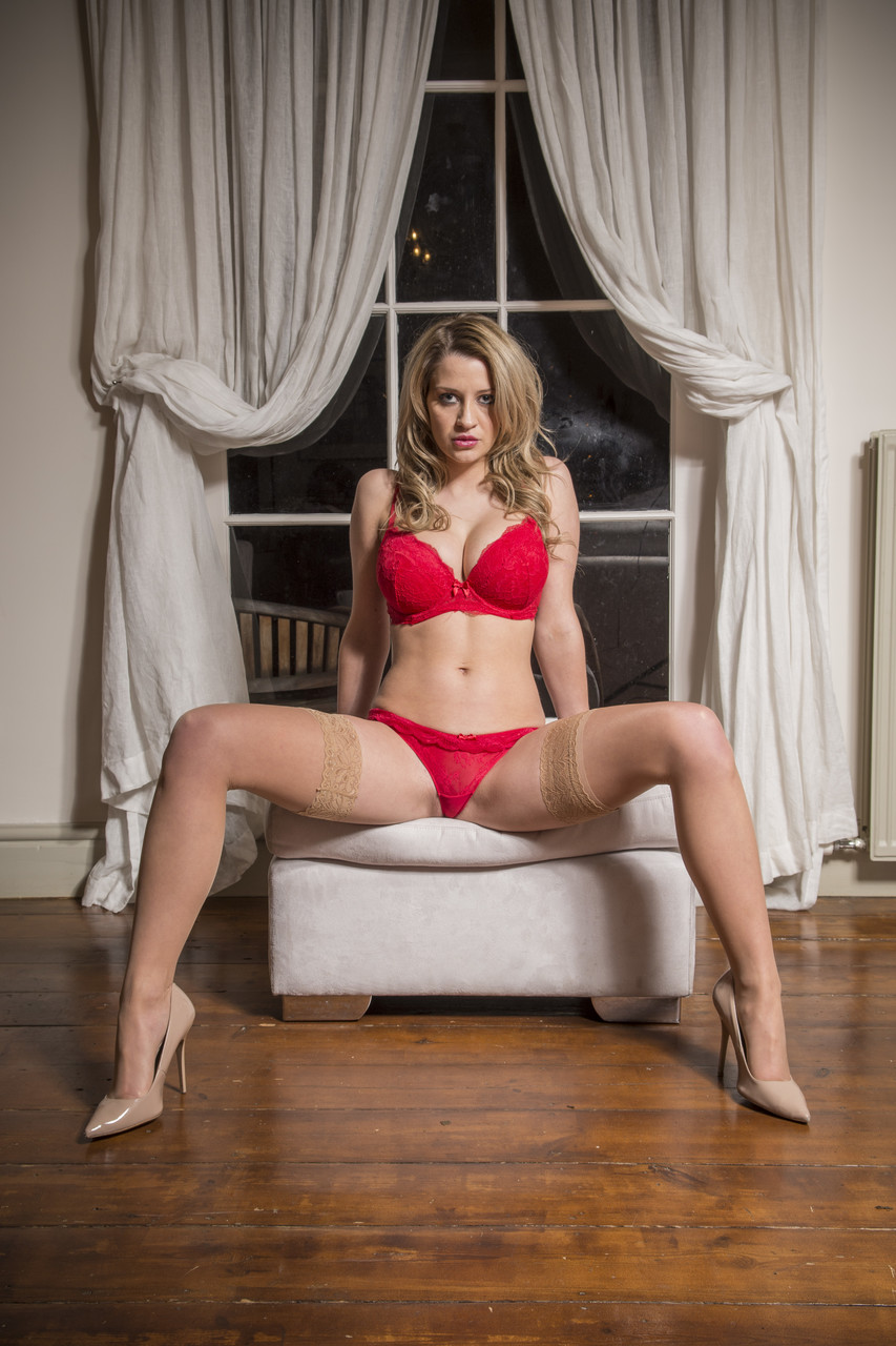 Blonde model Sienna Day flaunts full size ass in front of the window in thong