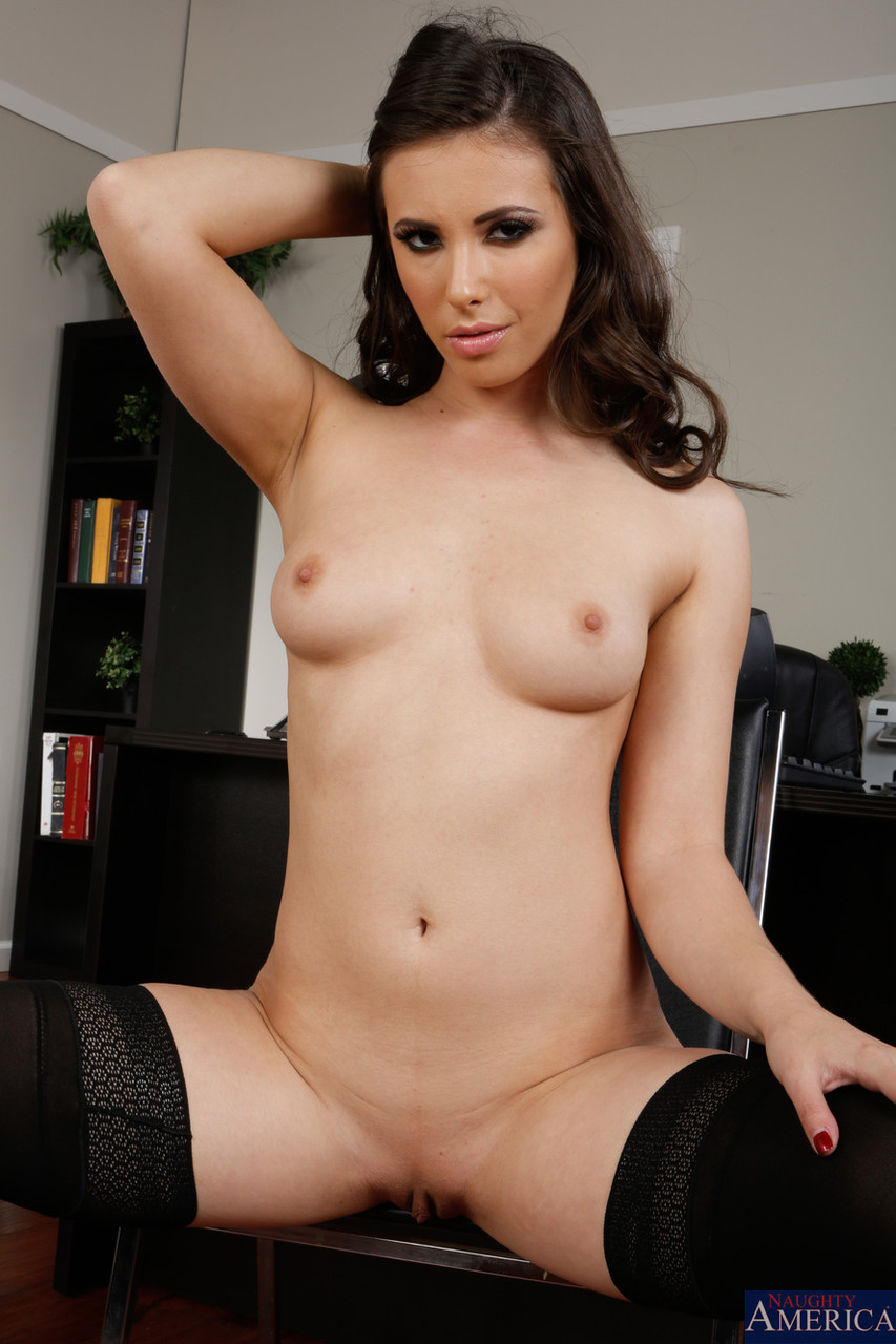 Beautiful brunette Casey Calvert unveils her small tits and flaunts her muff
