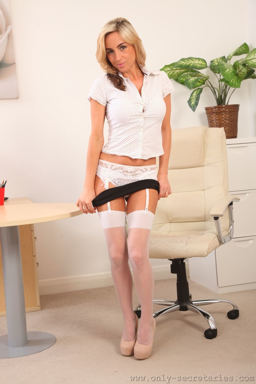 Amateur secretary Melanie strips in the office chair and poses in lingerie