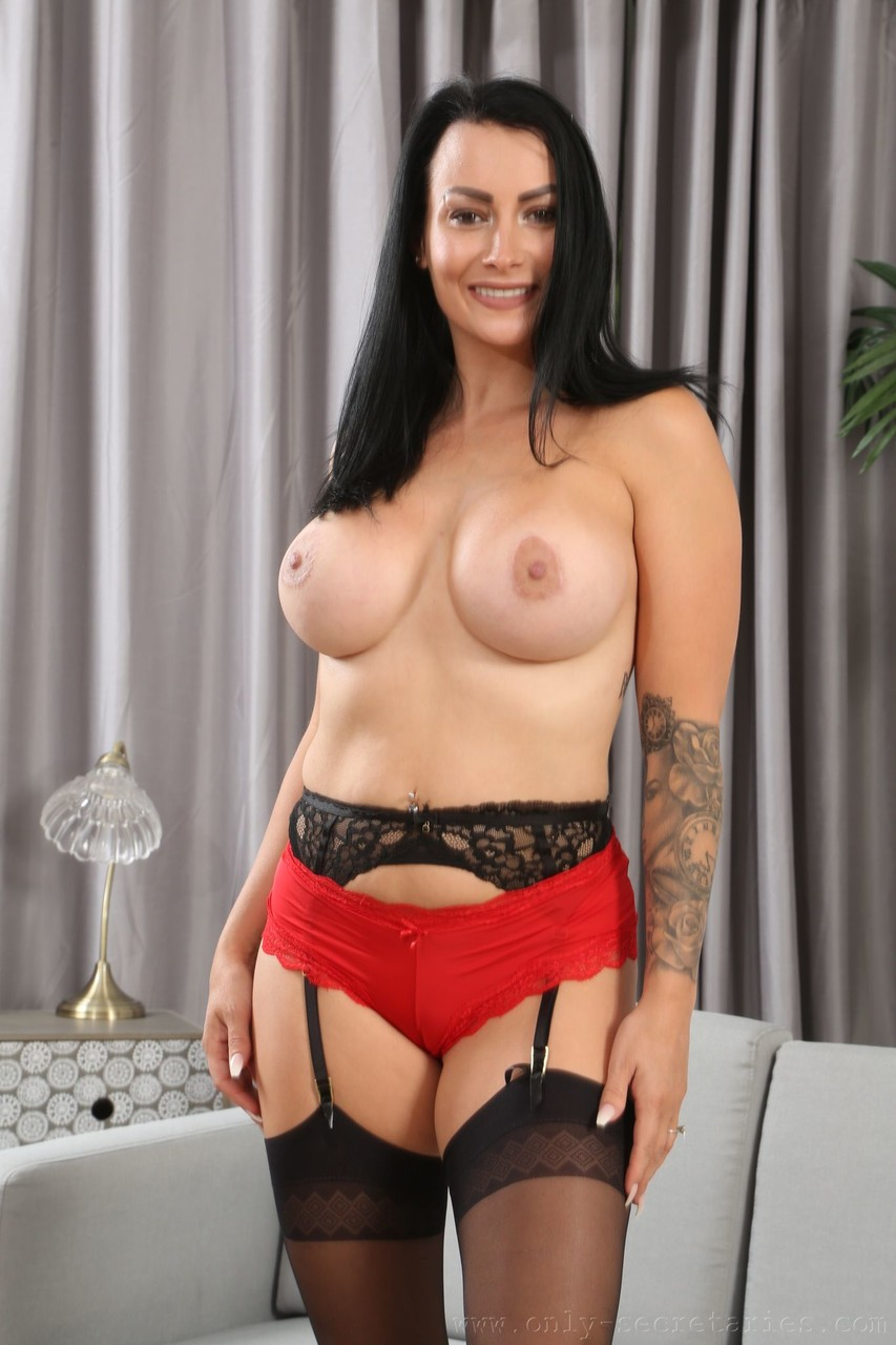Stunning black haired babe Kelli Smith doffs her red dress and shows big tits