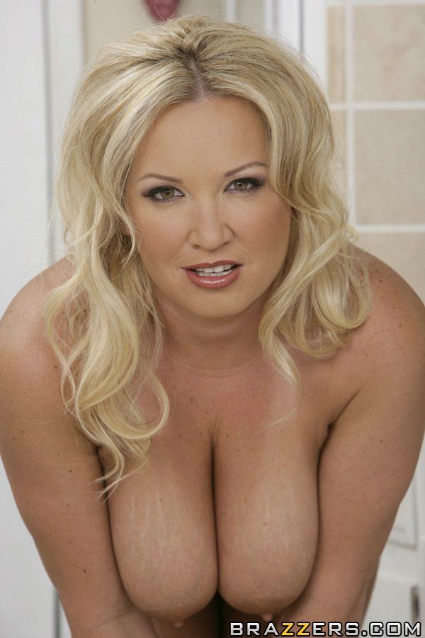 Busty blonde MILF Rachel Love fingers her cunt and shows huge boobs solo