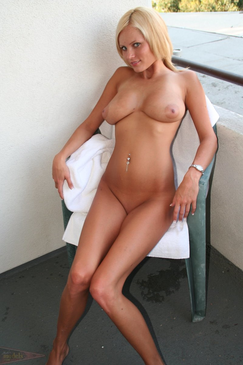 Blue-eyed blonde Hanna unleashes her great tits before showing her pink twat