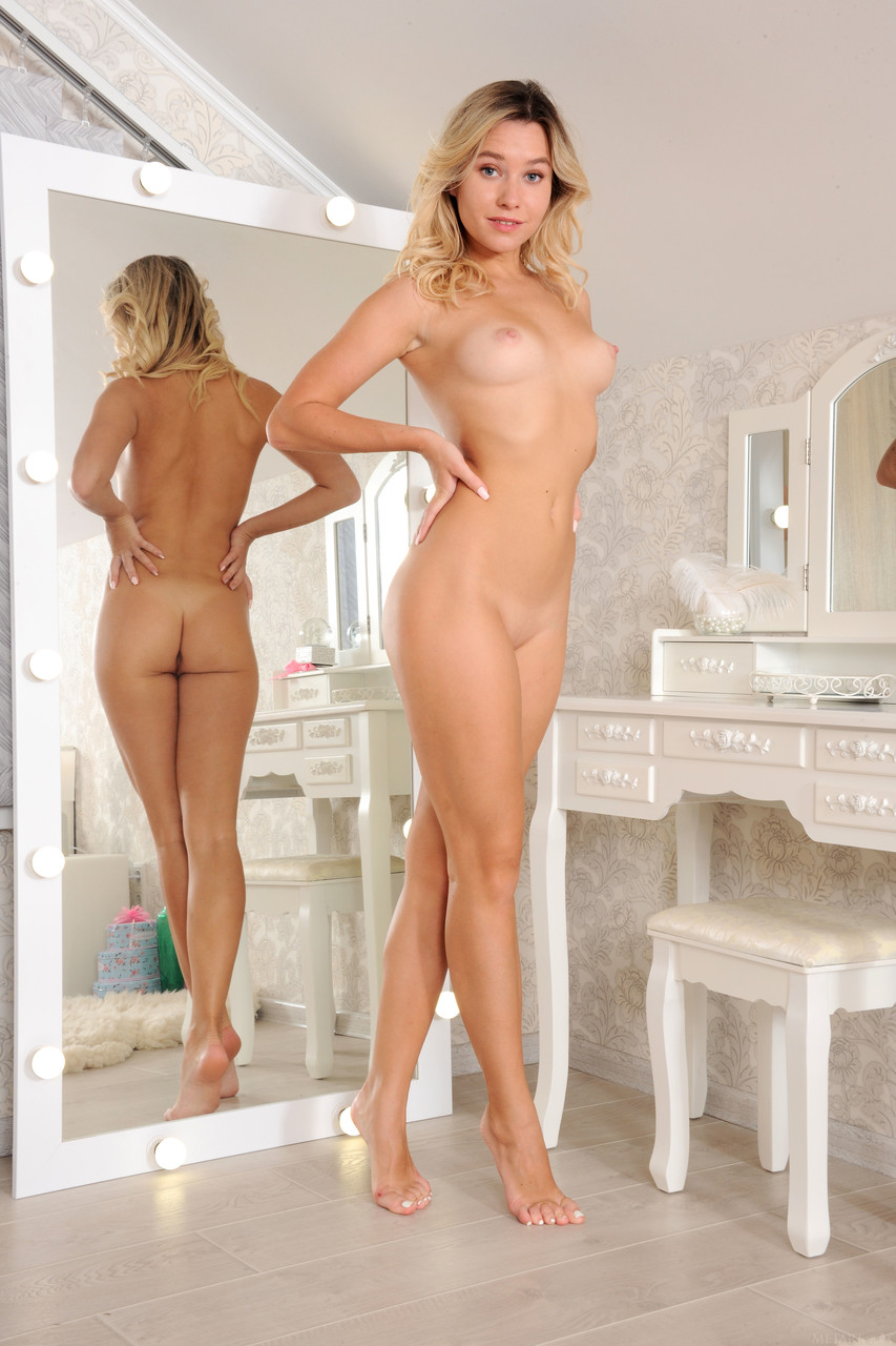 Skinny teen Angelina Ash reveals her sexy soft body and poses nude in a solo