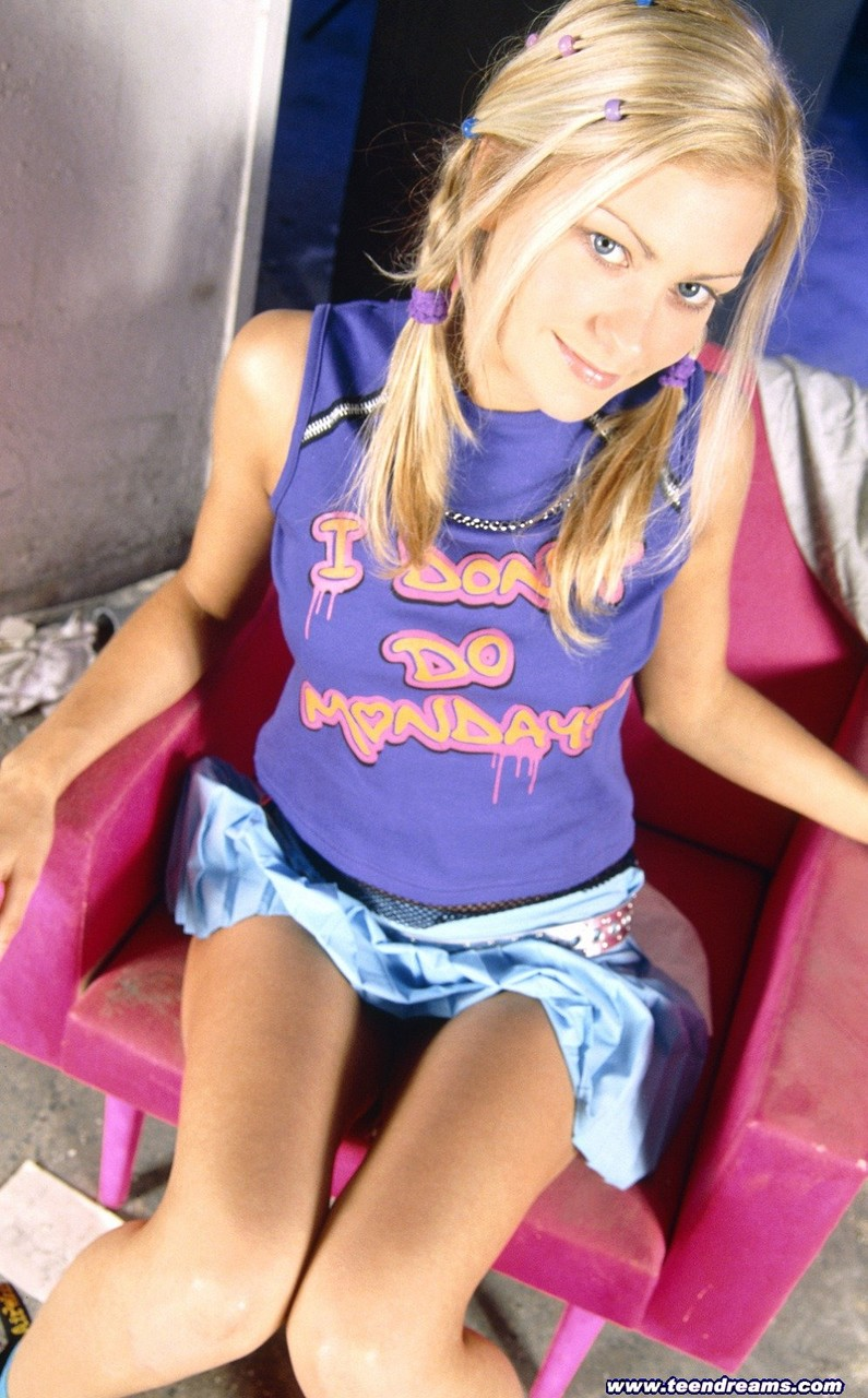 Skinny blonde teen Marci spreading her inviting pink pussy wide