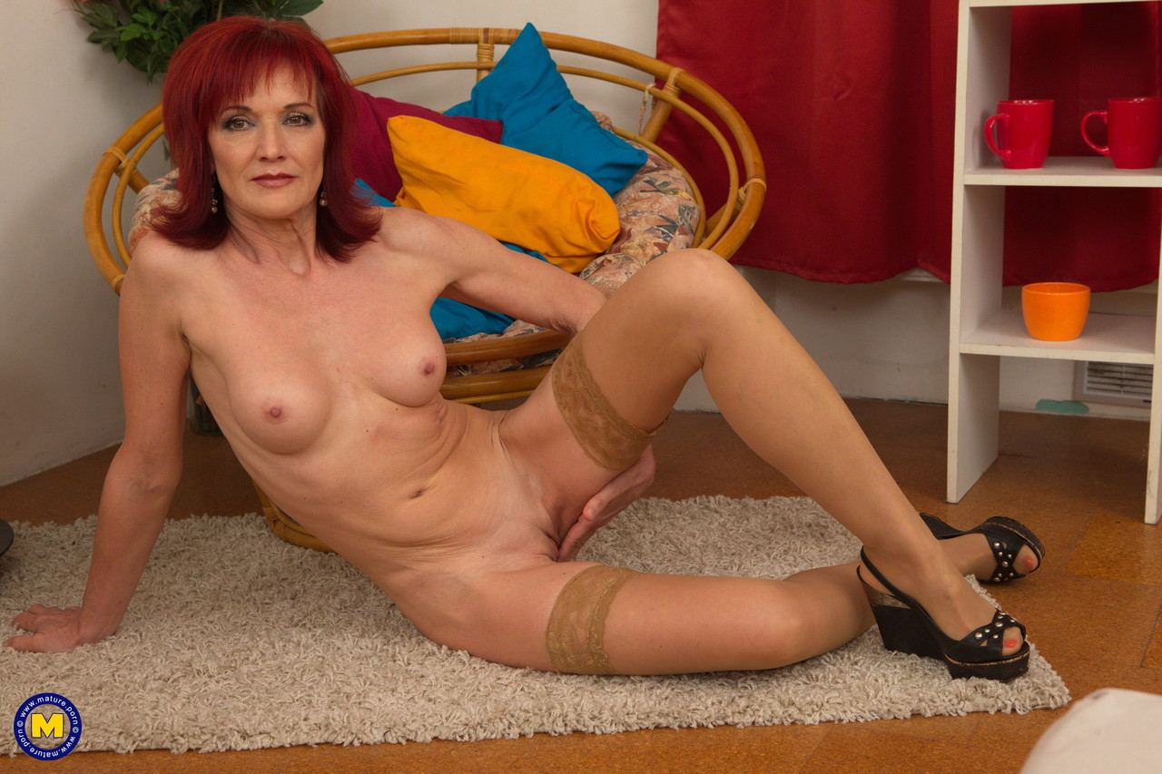 Mature housewife with red hair strips to tan stockings before masturbating