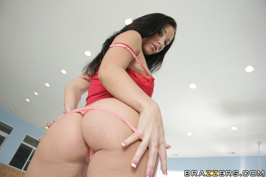 Jayden Jaymes in high heels shows her big fake tits and her tattoos