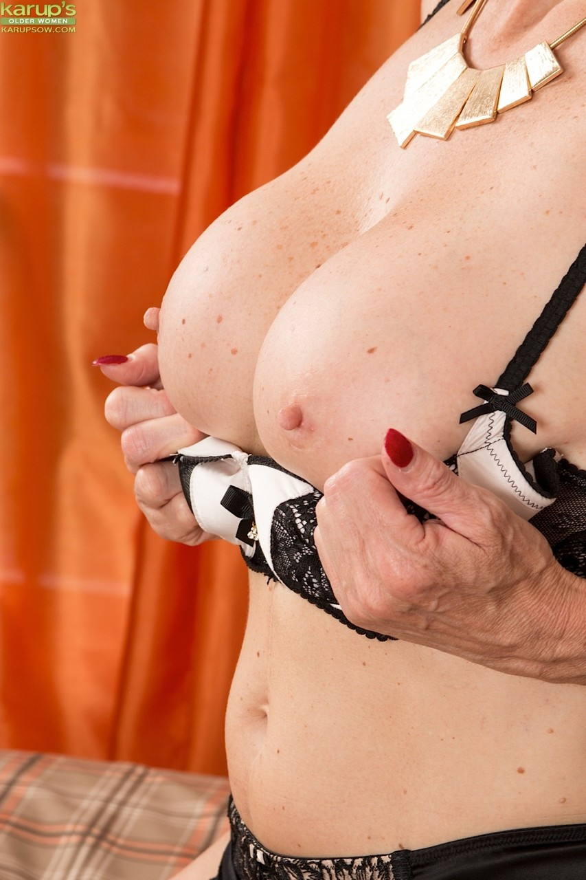 Older blonde Molly Maracas parts her meaty labia lips with red fingernails