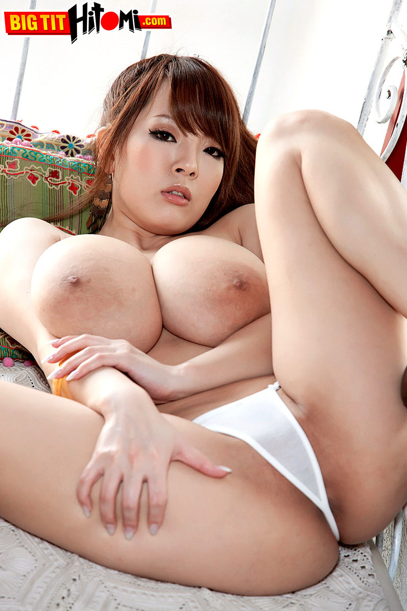 Attractive Japanese housewife Hitomi loses yellow top & shows her monster tits