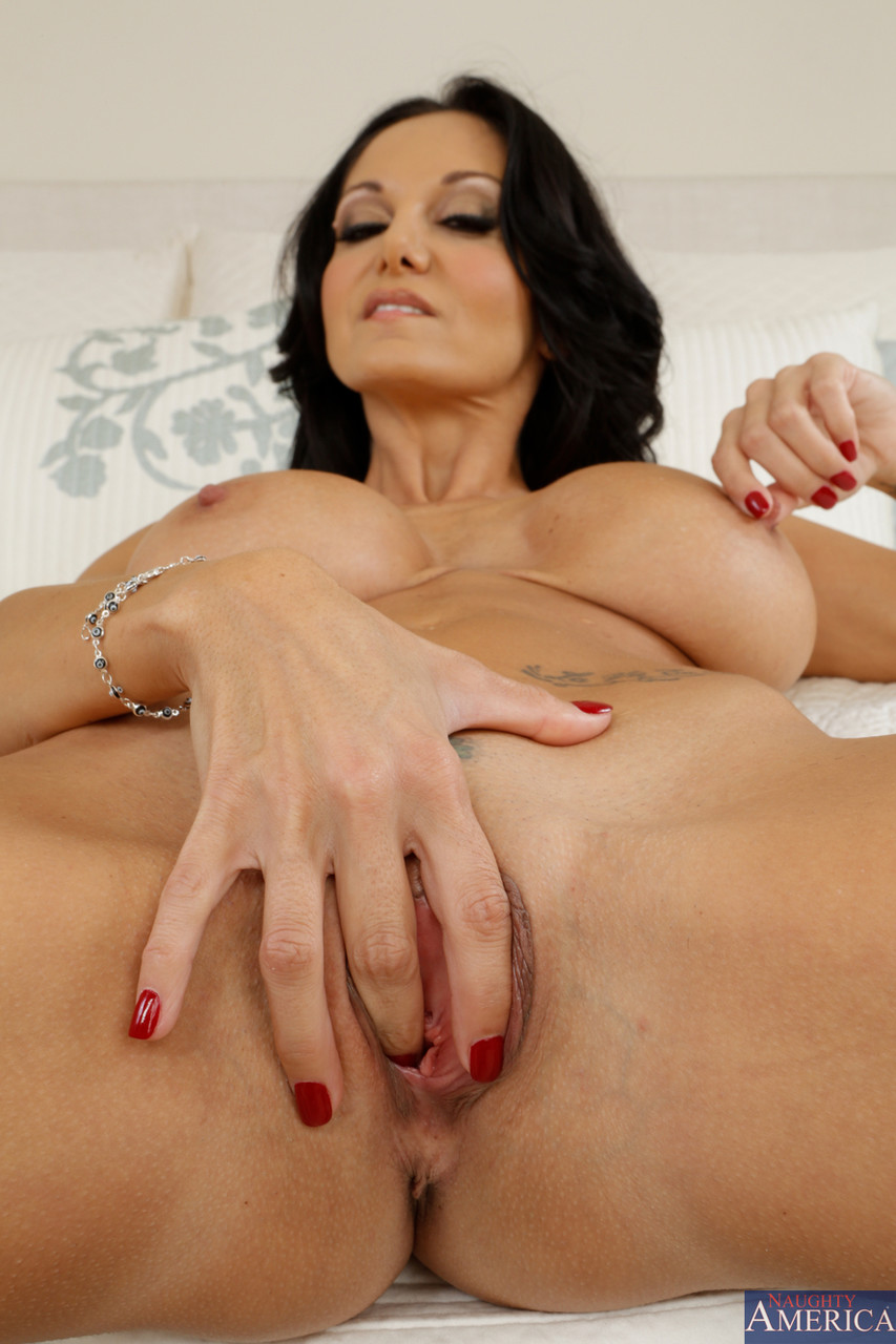 Hot MILF Ava Addams strips to bare big tits & spreads her pussy on the bed