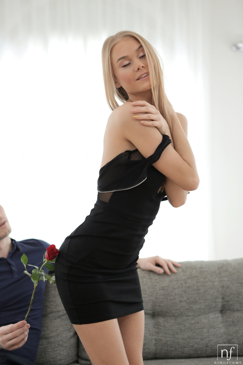Sexy blonde Nancy A drops her black dress to ride her man's cock on the sofa