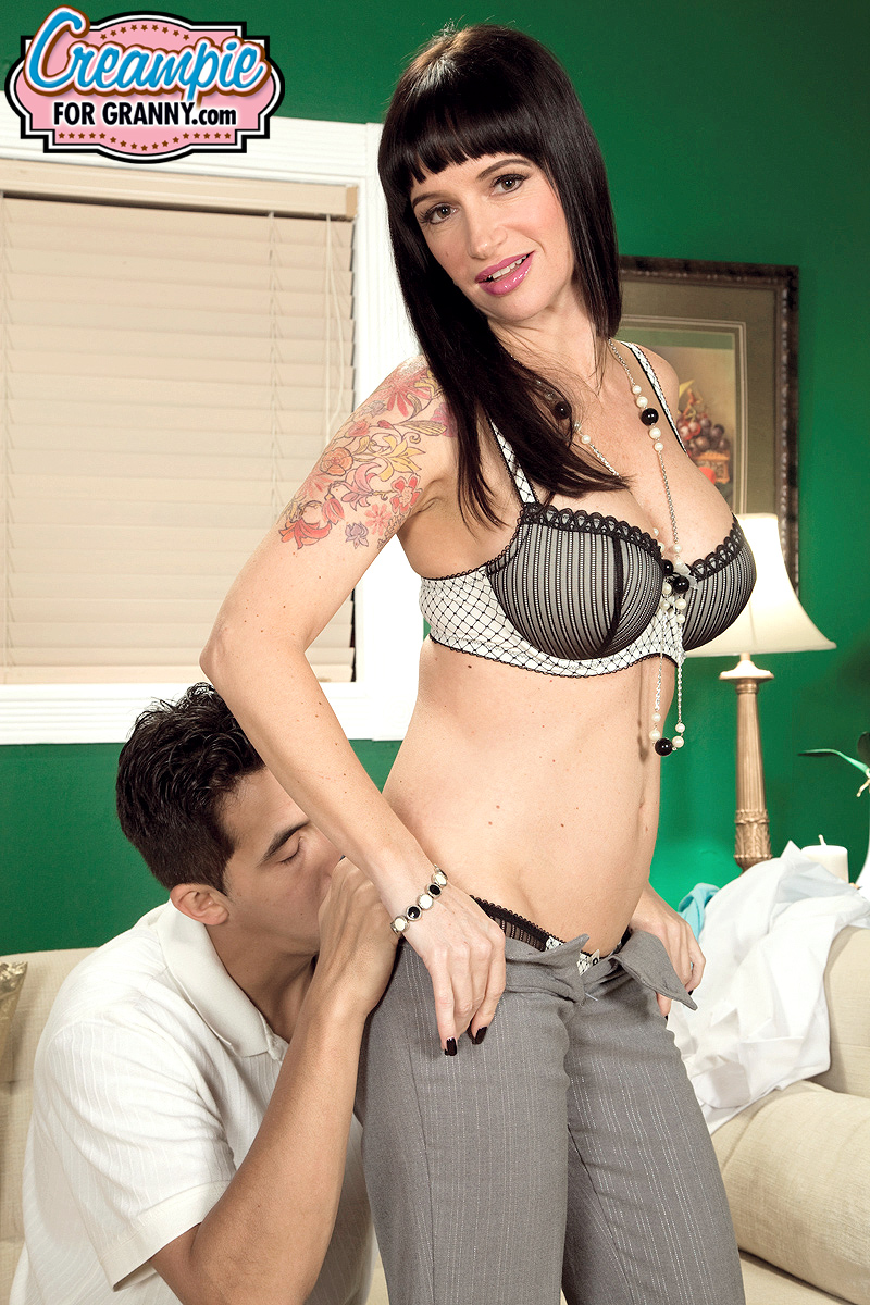 Hot black-haired woman Angie Noir gets her shaved pussy filled with cum