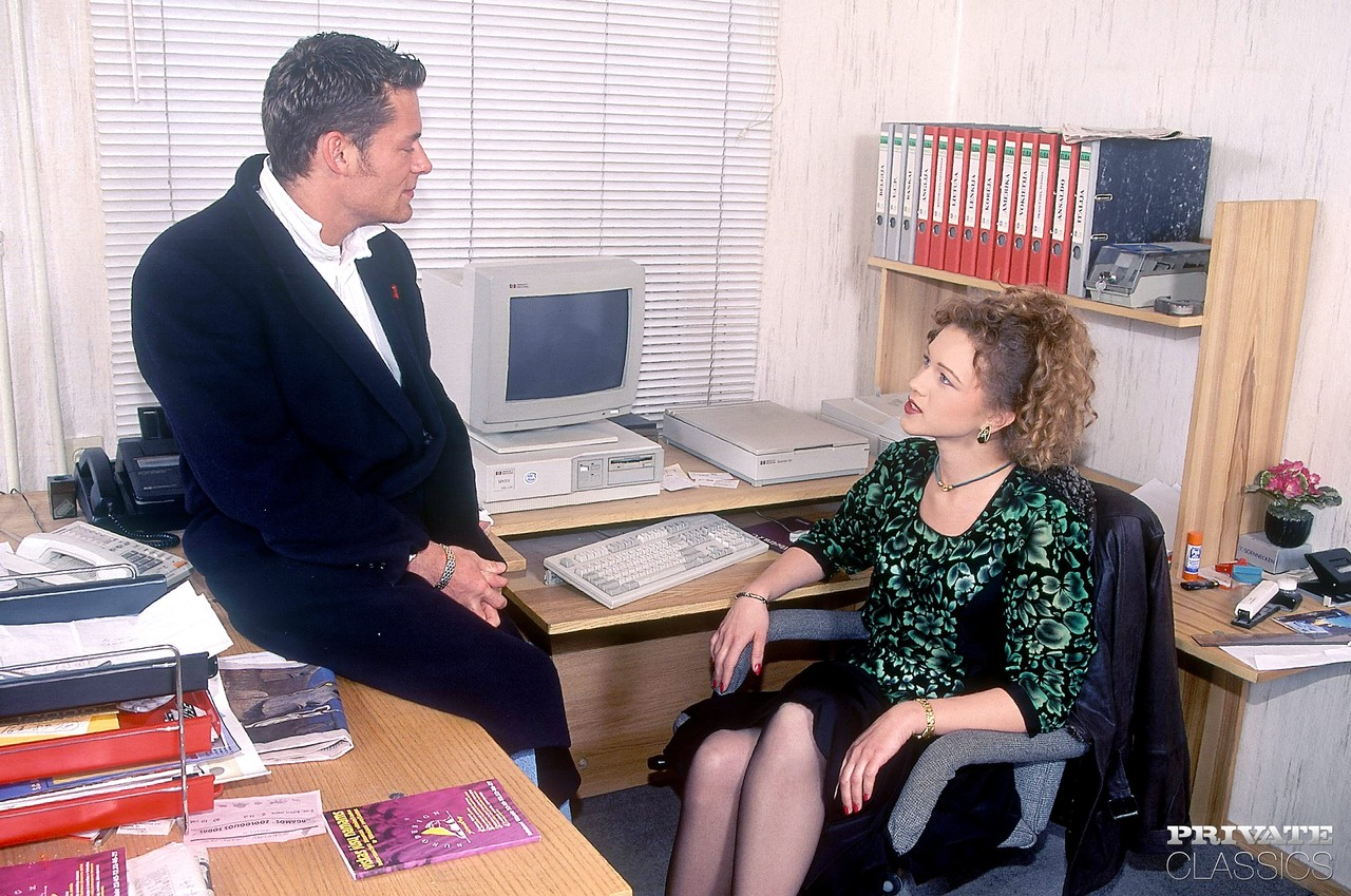 Curly haired secretary from the 70s does a double penetration at work