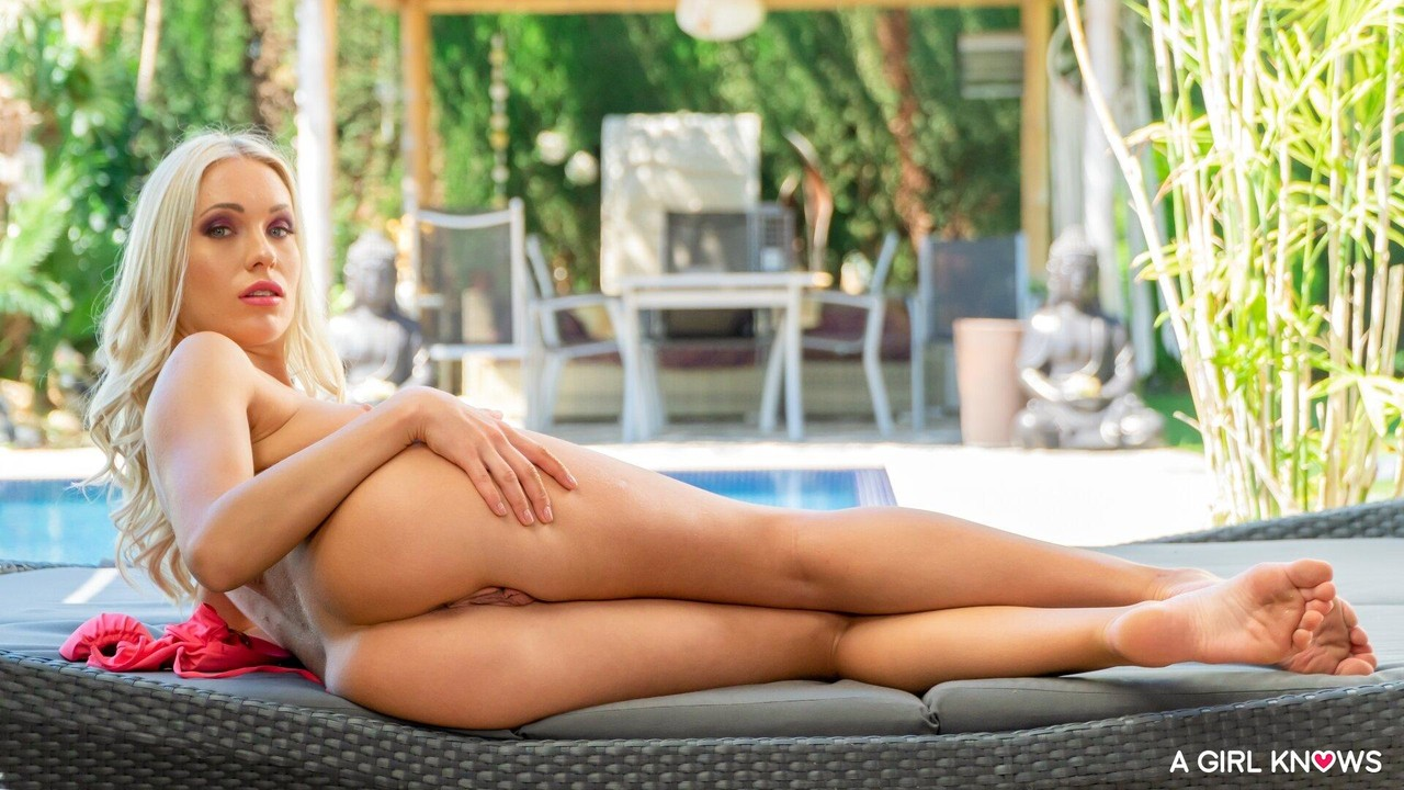 Blonde European Angelika Grays strips before toying her pussy by the pool