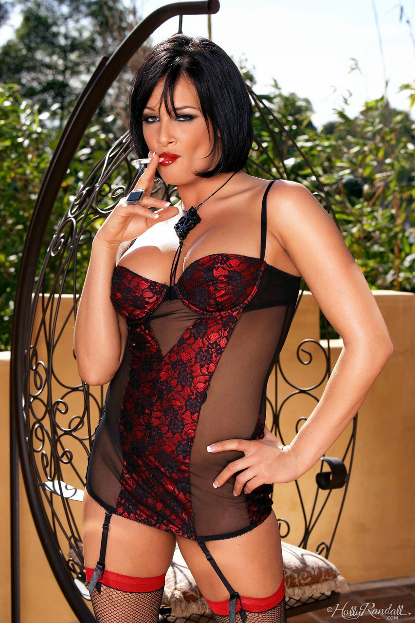 Centerfold model Tory Lane smokes before freeing tits and twat from lingerie