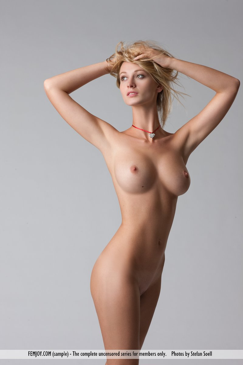 Long legged blonde Carisha spreading ass naked and flaunting her firm big tits