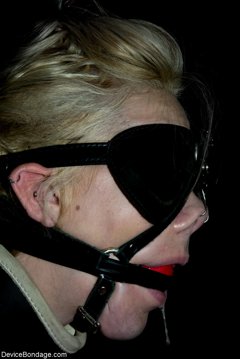 Naked blonde female is ball gagged and restrained during sensory deprivation