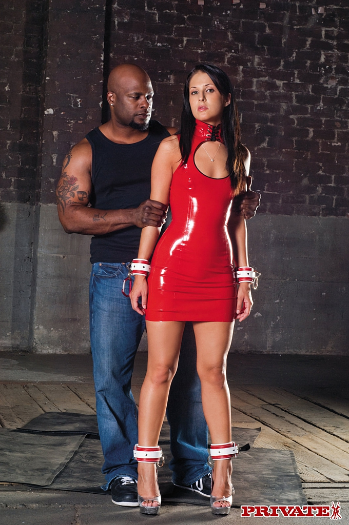 Sexy babe in a red latex dress Chelsea Rae gets her butthole blacked