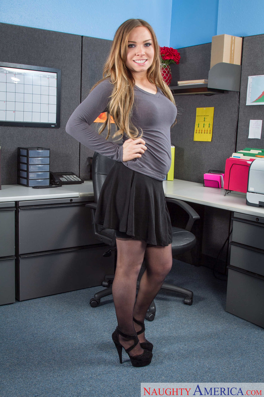 Beautiful busty secretary Tiff Bannister indulging in a sexy office striptease