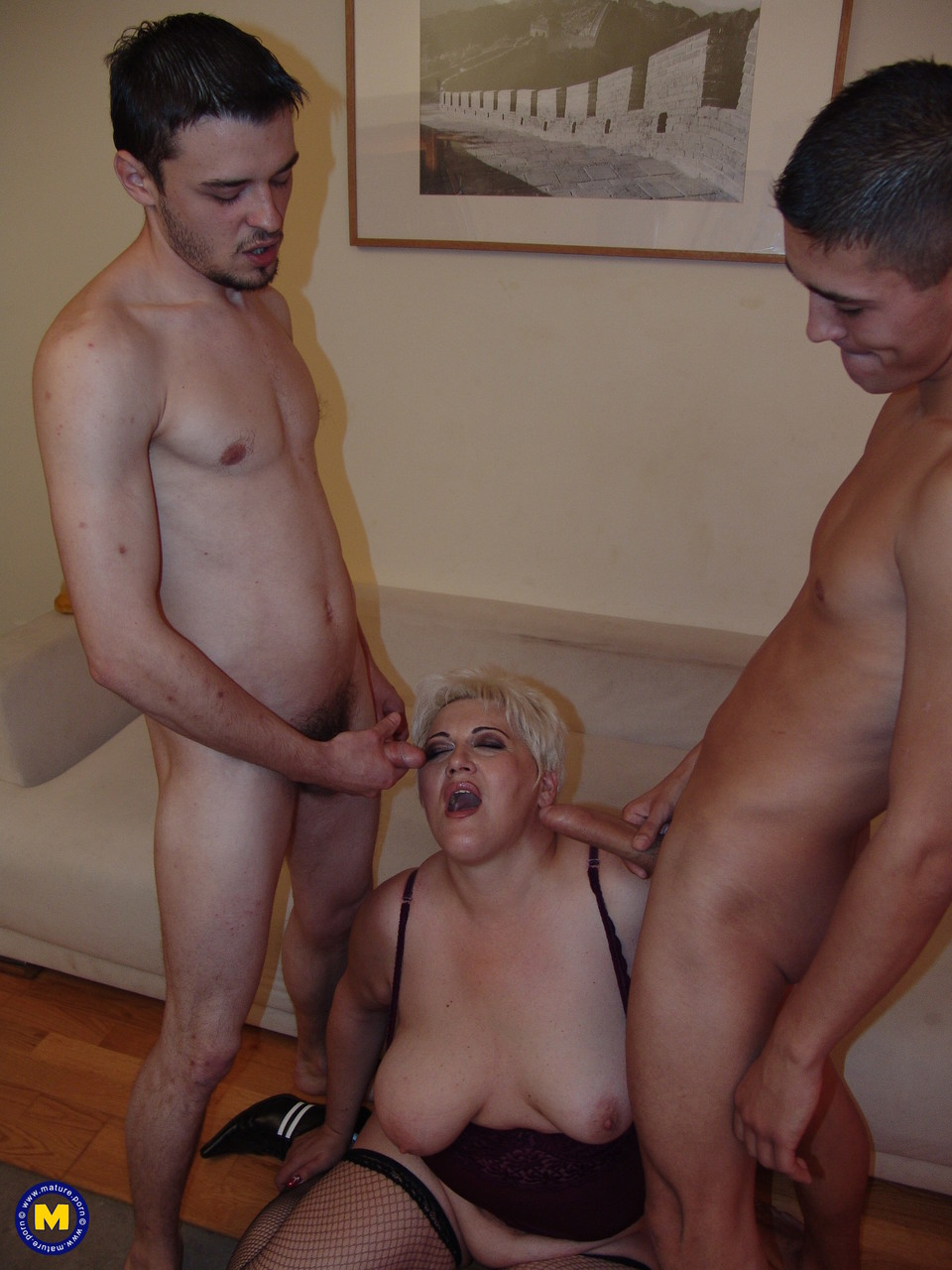 Blonde granny Magdalena exposes her big ass and gets rammed by two lovers