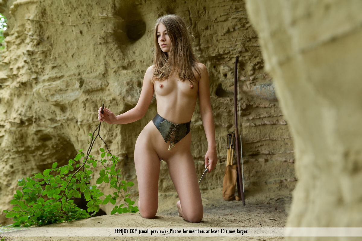 Blonde teen Nastya H goes naked and barefoot while bow hunting