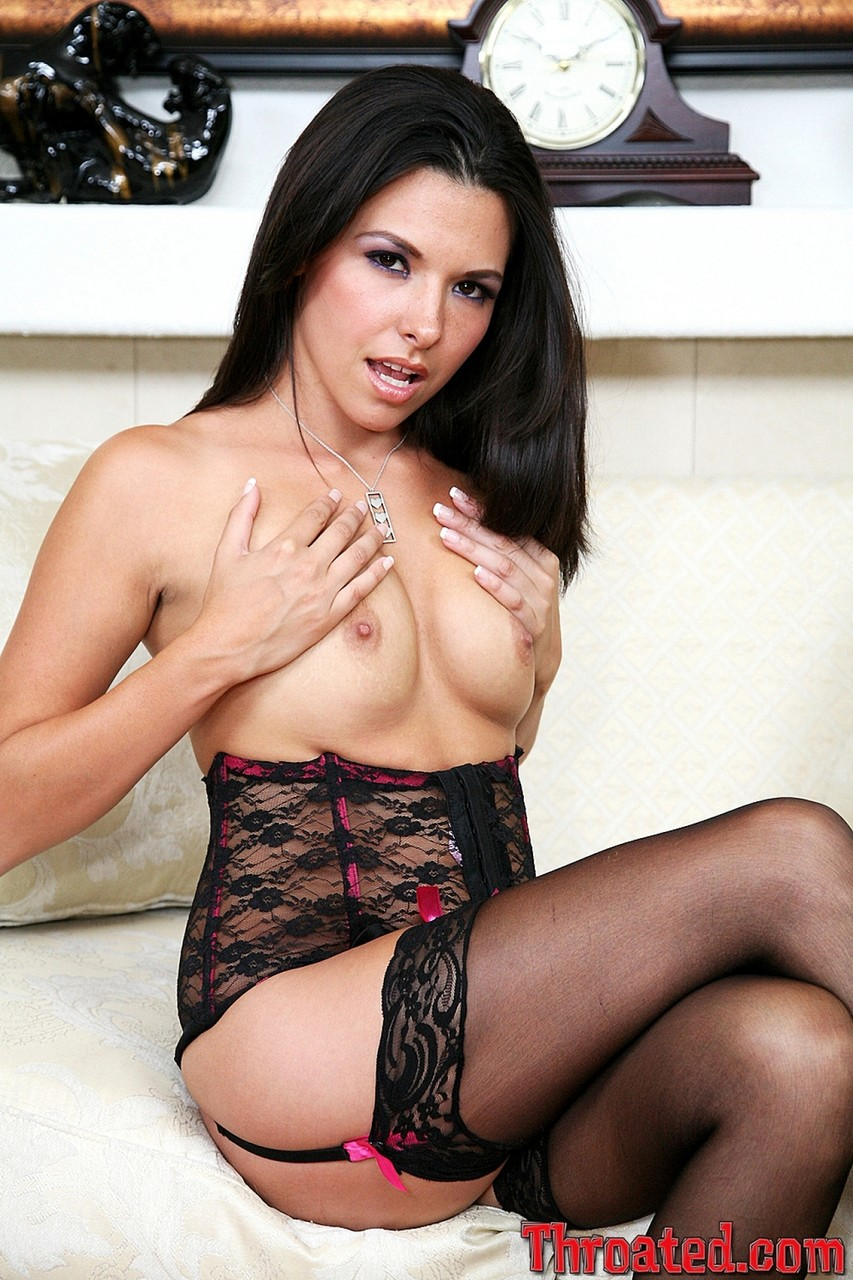 Gorgeous black haired Danica Dillan shows her small tits in sexy lace corset