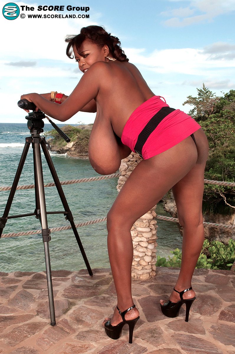 Black woman sets her massive breasts free while at a lookout spot