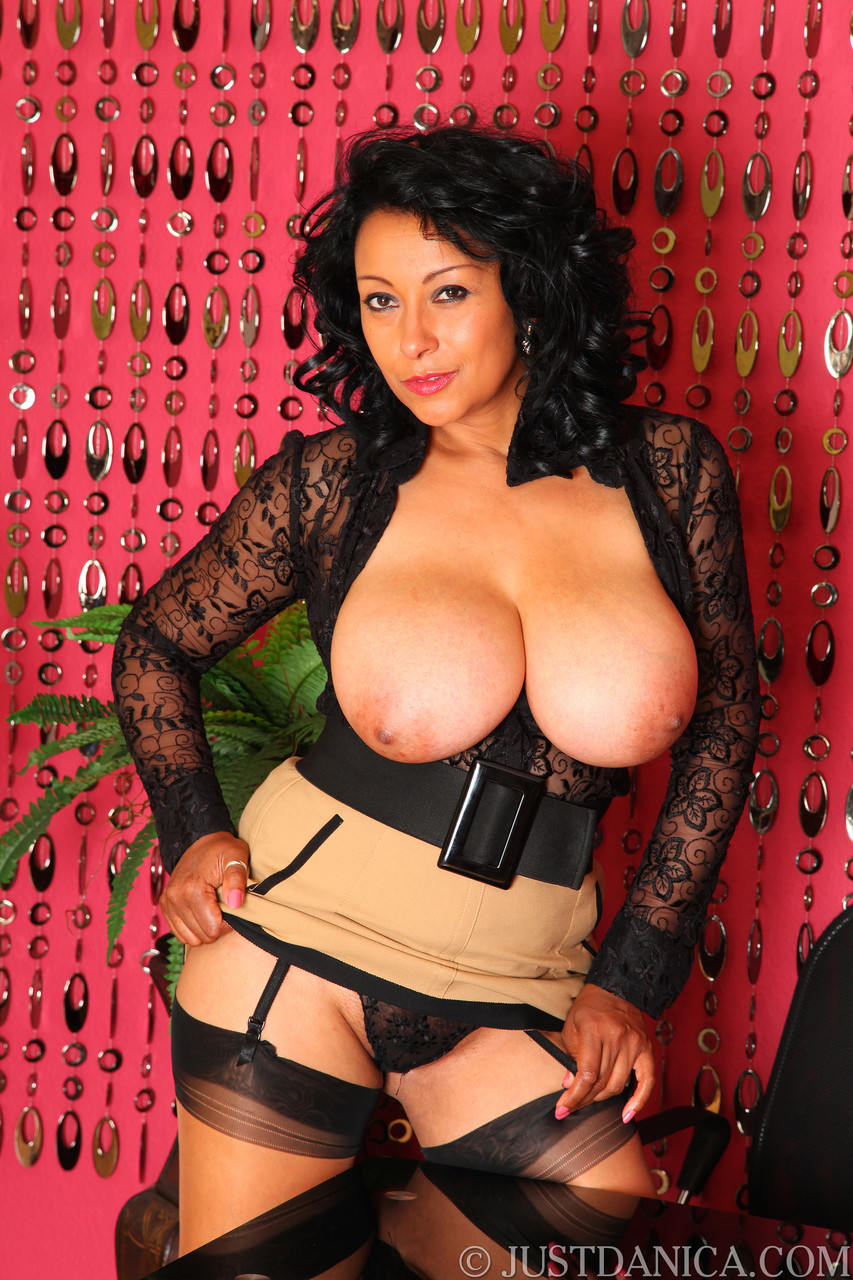 Sexy cougar in lacy lingerie Danica Collins reveals her big juggs and poses