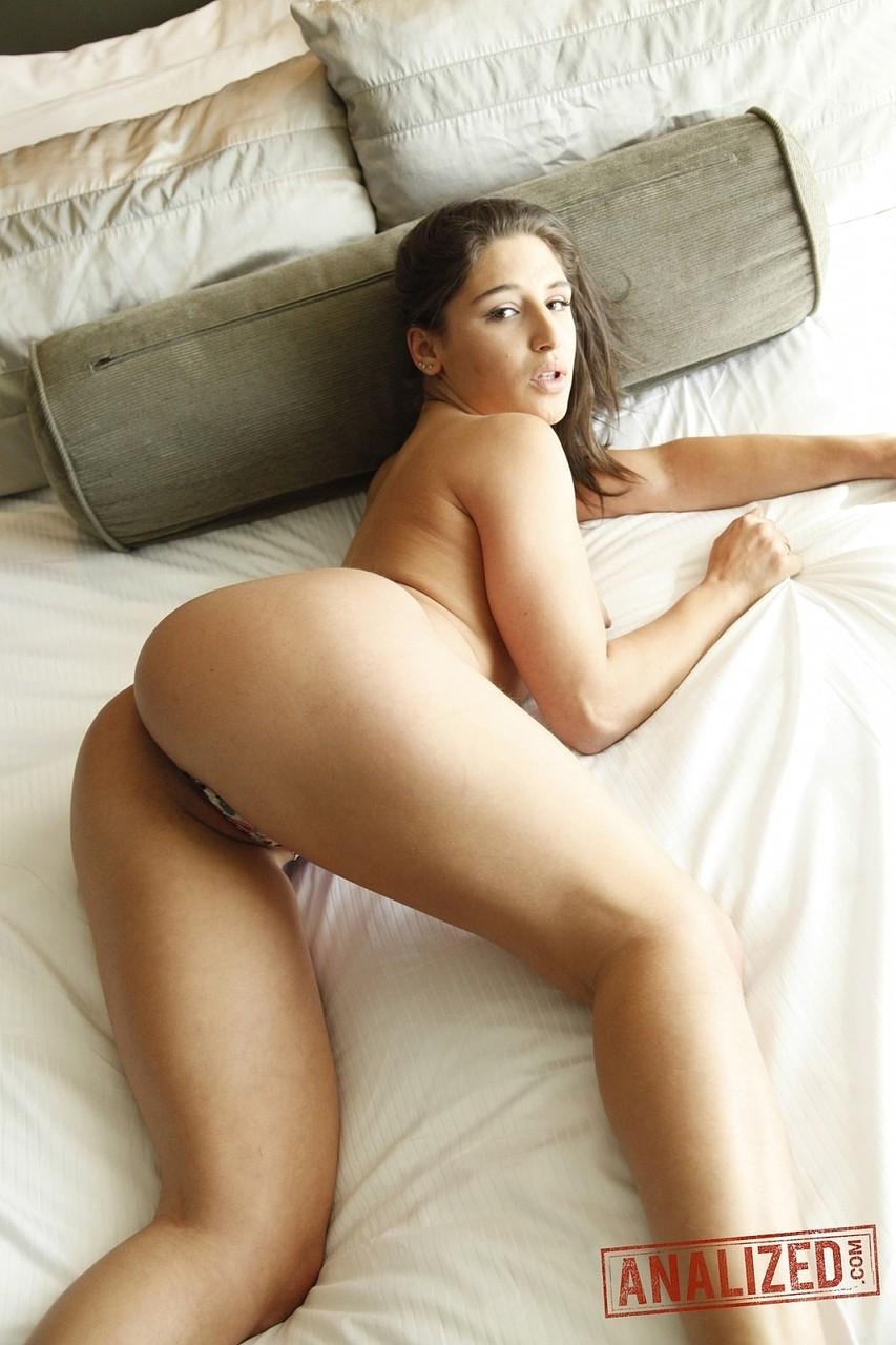 Beautiful pornstar Abella Danger flaunts her ass and vulva in her bedroom