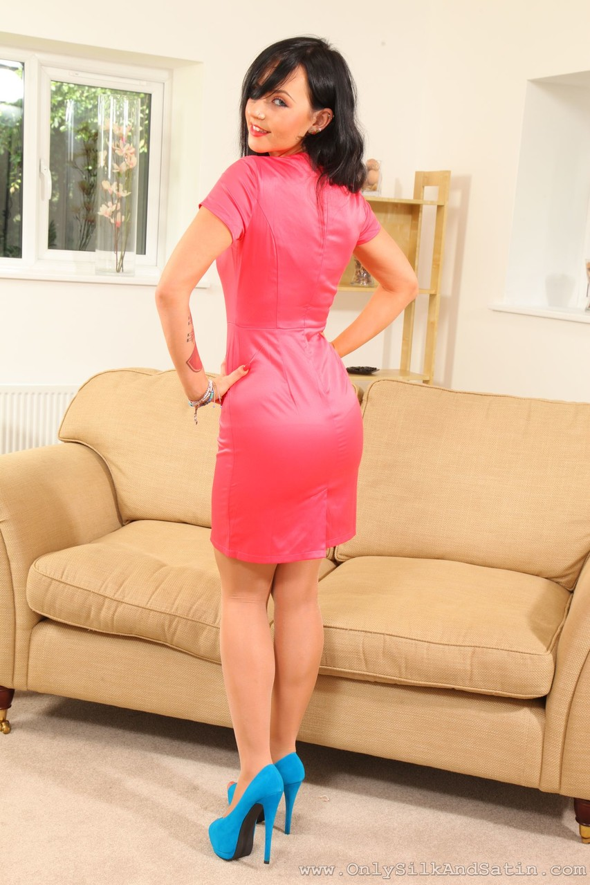 Tattooed doll Molly May strips on the sofa & poses in smooth pantyhose