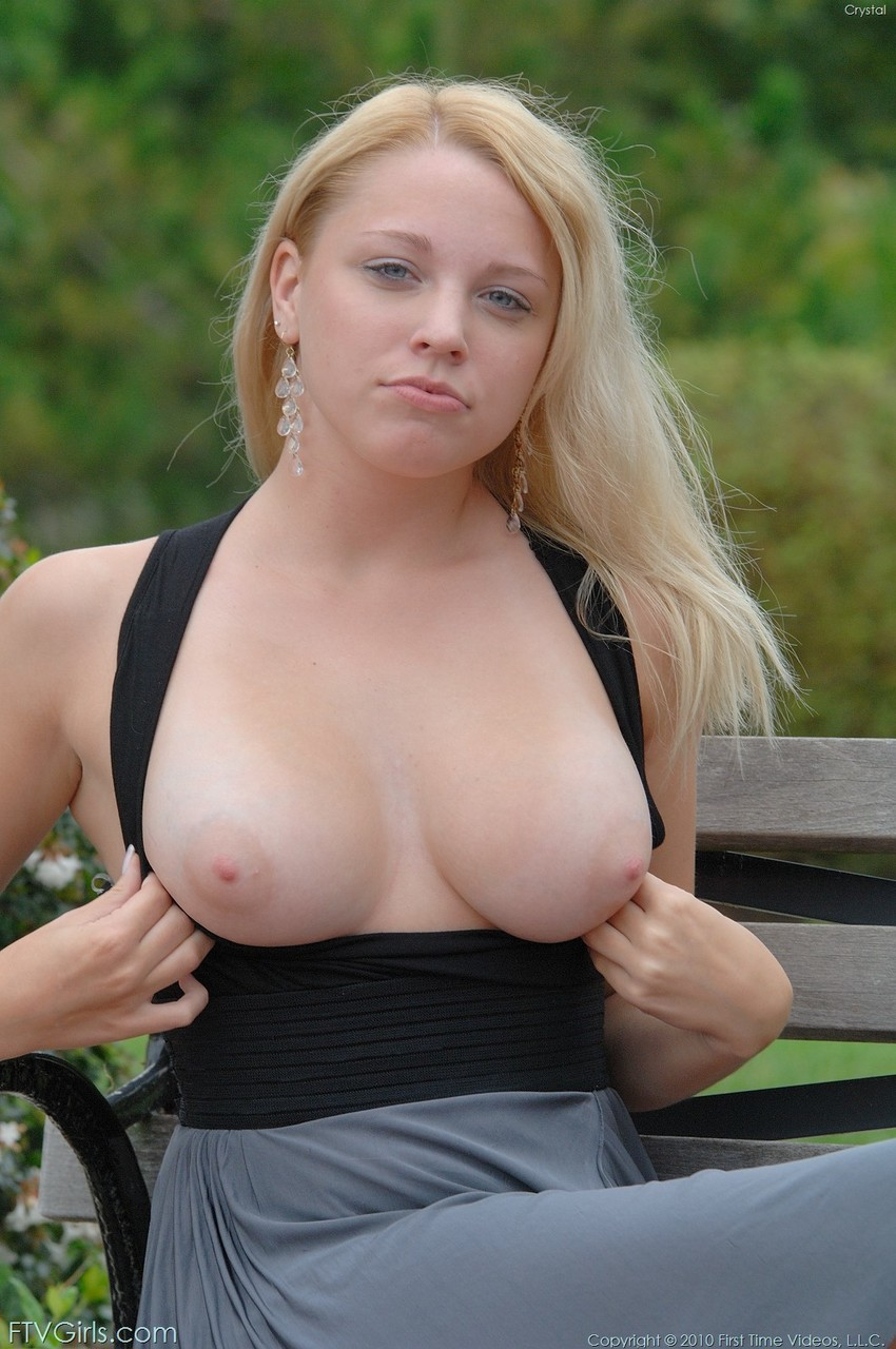 Luscious blonde Crystal flashing her natural boobs and bald pussy in public